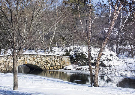 park-snow-scene-with-stone-bridge-stock-images_csp33681354